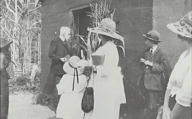 Rev. F.V. Pratt opening the door, Mrs Jeffreys in foreground