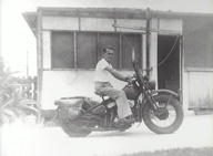 Lionel Hogan riding Harley Davidson, Ashbury, ca 1946